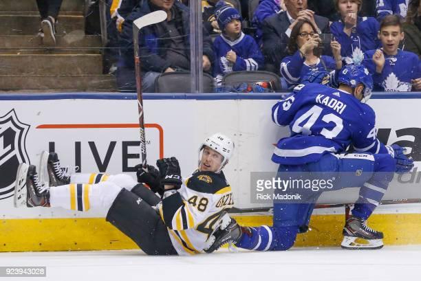 Boston Bruins defenseman Matt Grzelcyk and Toronto Maple Leafs center Nazem Kadri collide along the side boards Toronto Maple Leafs VS New Jersey...
