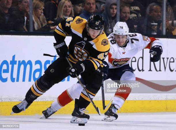 Boston Bruins defenseman Torey Krug controls the puck with pressure from Florida Panthers center Maxim Mamin during the third period The Boston...