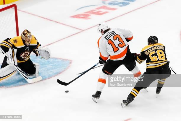 Boston Bruins defenseman Urho Vaakanainen thwarts the breakaway from Philadelphia Flyers right wing Kevin Hayes during a preseason game between the...