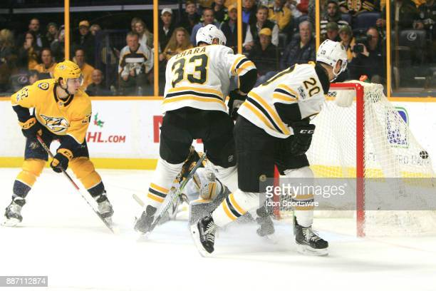 Boston Bruins defenseman Zdeno Chara and Boston Bruins center Riley Nash look on as Nashville Predators left wing Kevin Fiala scores on Boston Bruins...