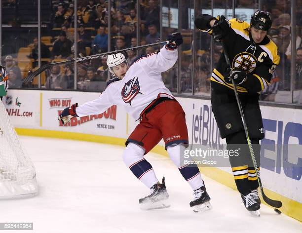 Boston Bruins defenseman Zdeno Chara is checked into the boards by Columbus Blue Jackets right wing Josh Anderson during the first period The Boston...