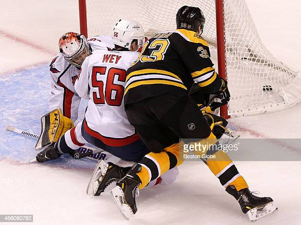 Boston Bruins defenseman Zdeno Chara slips a power play goal through the legs of Washington Capitals goalie Pheonix Copley for what turned out to be...