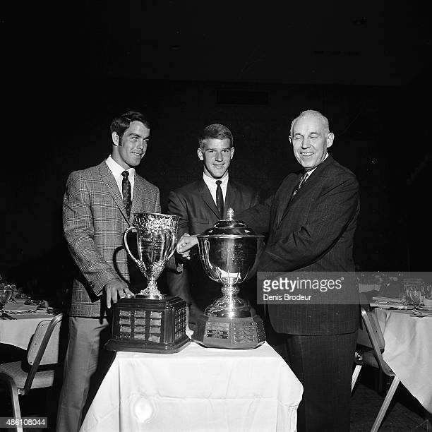 Boston Bruins Derek Saunderson with the Calder Memorial Trophy and Bobby Orr with the James Norris Memorial Trophy after the NHL Awards Ceremony...