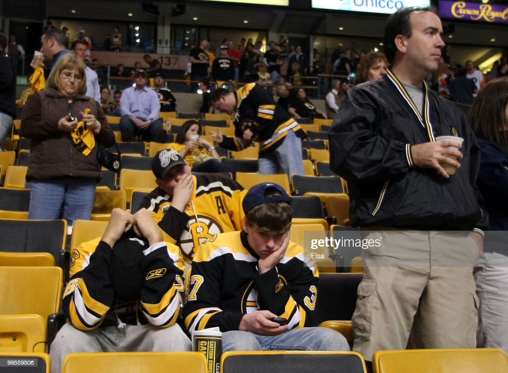 Boston Bruins fans react after their team lost to the Philadelphia Flyers in Game Seven of the Eastern Conference Semifinals during the 2010 NHL Stanley Cup Playoffs at TD Garden on May 14, 2010 in Boston, Massachusetts. The Flyers defeated the Bruins 4-3.