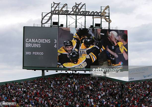 Boston Bruins fans were kept abreast of the score by updates to the Green Monster and Jumbotron scoreboards The Boston Red Sox take on the Oakland...