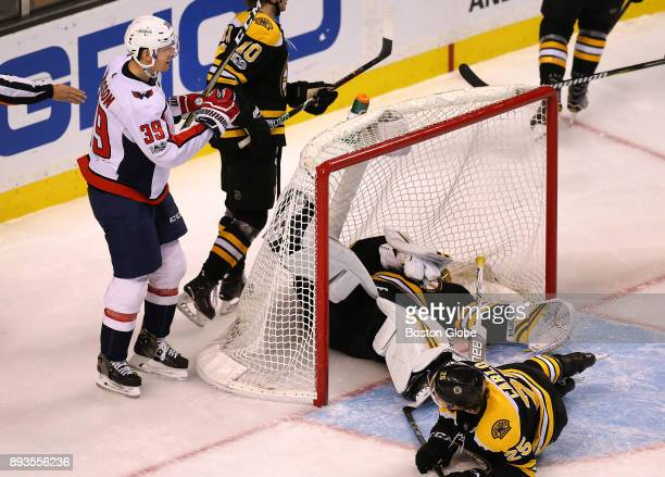 Boston Bruins goalie Anton Khudobin falls down in the net as he lets in a third period goal scored by Capitals' Alex Chiasson left as Bruins' Brandon...