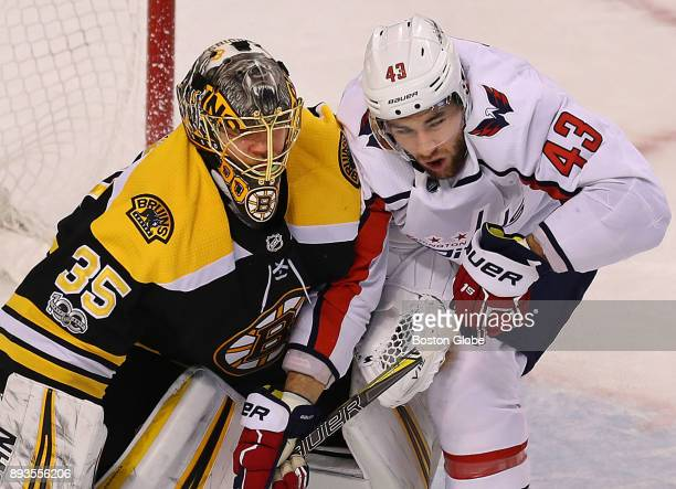 Boston Bruins goalie Anton Khudobin gets brushed by Capitals' Tom Wilson as he rushes the net in the first period The Boston Bruins host the...