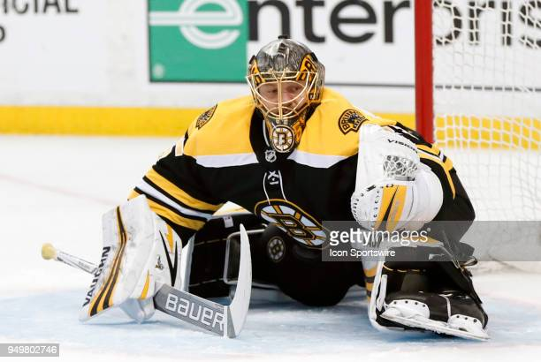 Boston Bruins goalie Anton Khudobin makes a glove save during Game 5 of the First Round for the 2018 Stanley Cup Playoffs between the Boston Bruins...