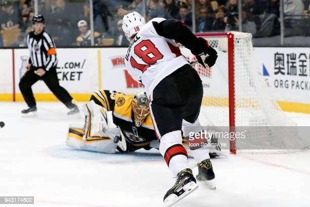 Boston Bruins goalie Anton Khudobin makes a point blank save on Ottawa Senators right wing Ryan Dzingel during a game between the Boston Bruins and...