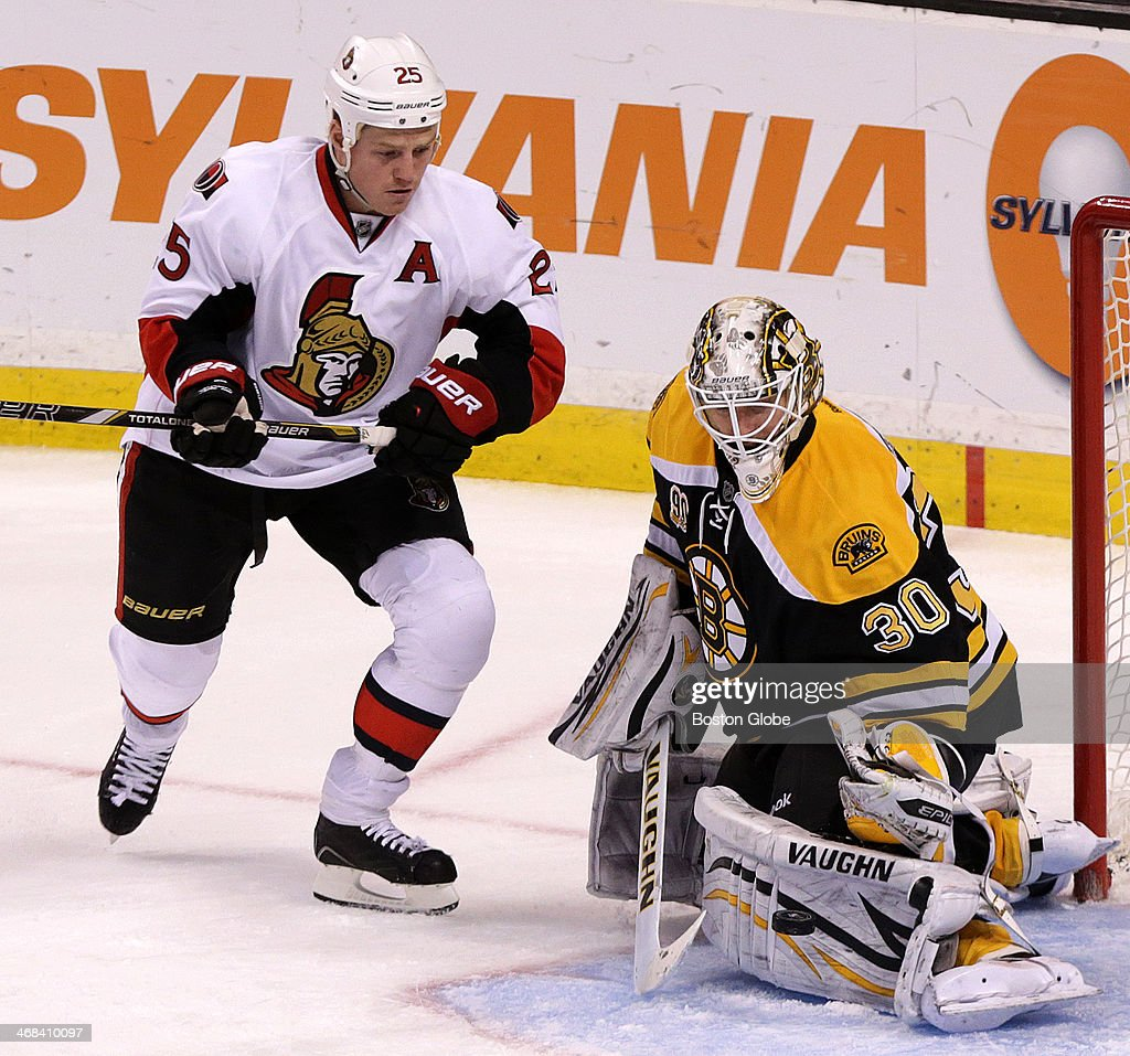 Boston Bruins goalie Chad Johnson (#30) makes a left pad save with Ottawa Senators right wing Chris Neil (#25) on his doorstep. The Boston Bruins take on the Ottawa Senators at TD Garden.