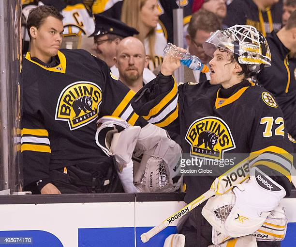 Boston Bruins goalie Niklas Svedberg takes a drink in front of teammate Tuukka Rask during a timeout against the Detroit Red Wings during third...