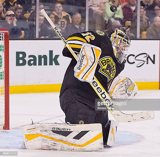 Boston Bruins goalie Niklas Svedberg using his head to deflect the puck against the Detroit Red Wings during third period action at the TD Garden on...