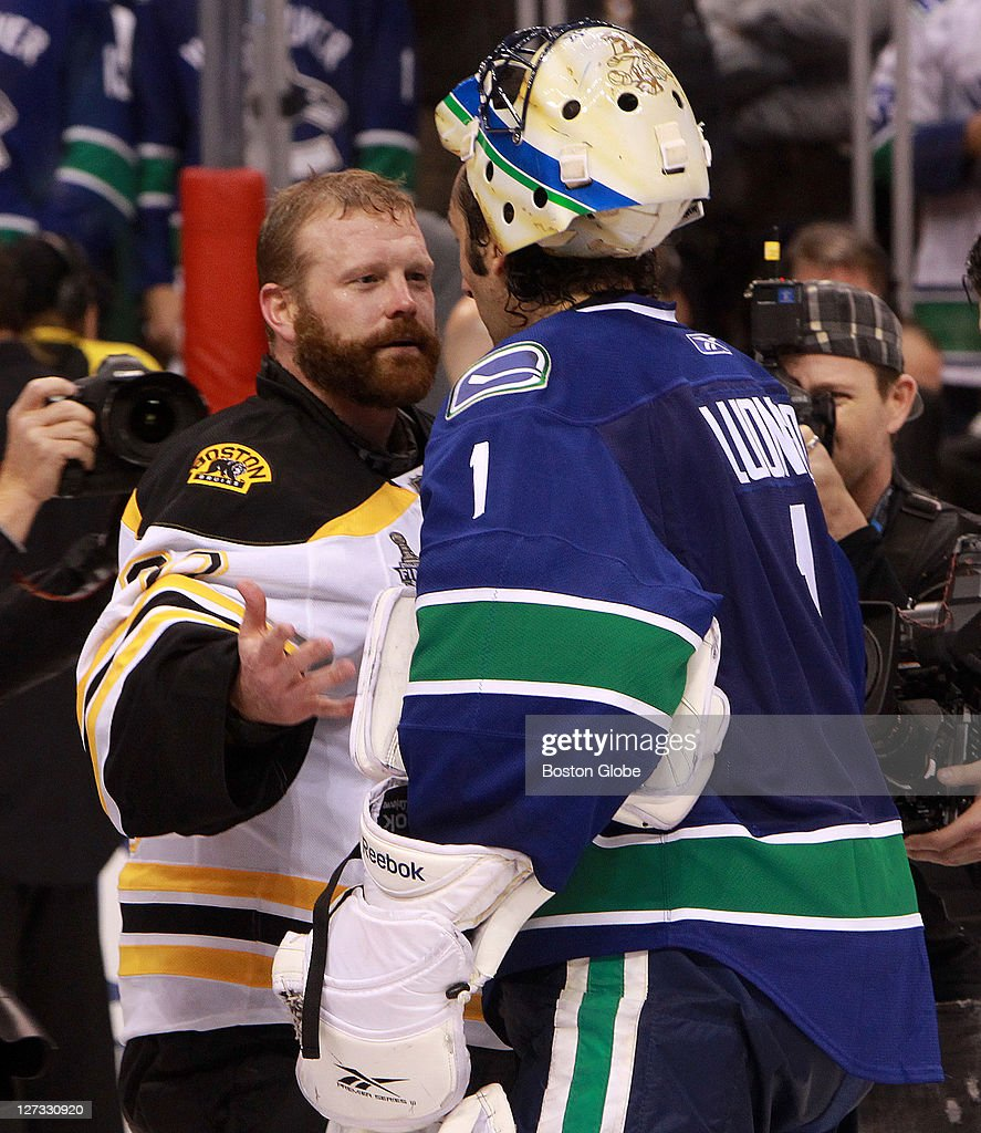Boston Bruins Goalie Tim Thomas And Vancouver Canucks Goalie Roberto