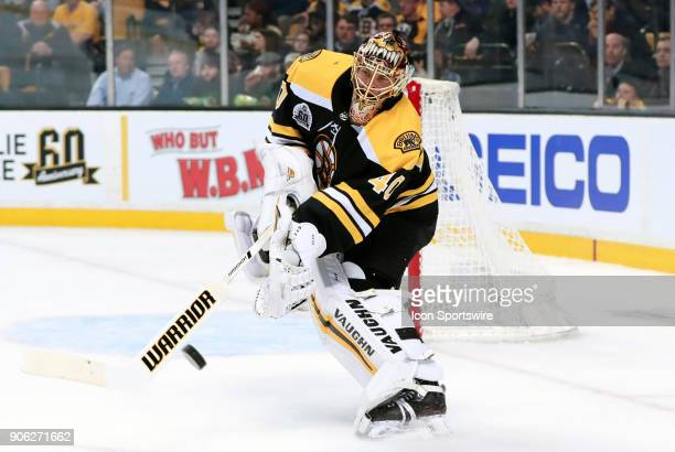 Boston Bruins goalie Tuukka Rask clears the puck from danger during a game between the Boston Bruins and the Montreal Canadiens on January 17 at TD...