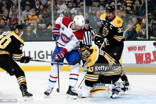 Boston Bruins goalie Tuukka Rask covers the puck with Montreal Canadiens left wing Max Pacioretty camped out in front during a game between the...