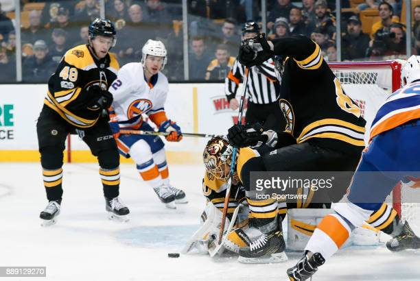 Boston Bruins goalie Tuukka Rask dives on a loose puck in front during a game between the Boston Bruins and the New York Islanders on December 9 at...