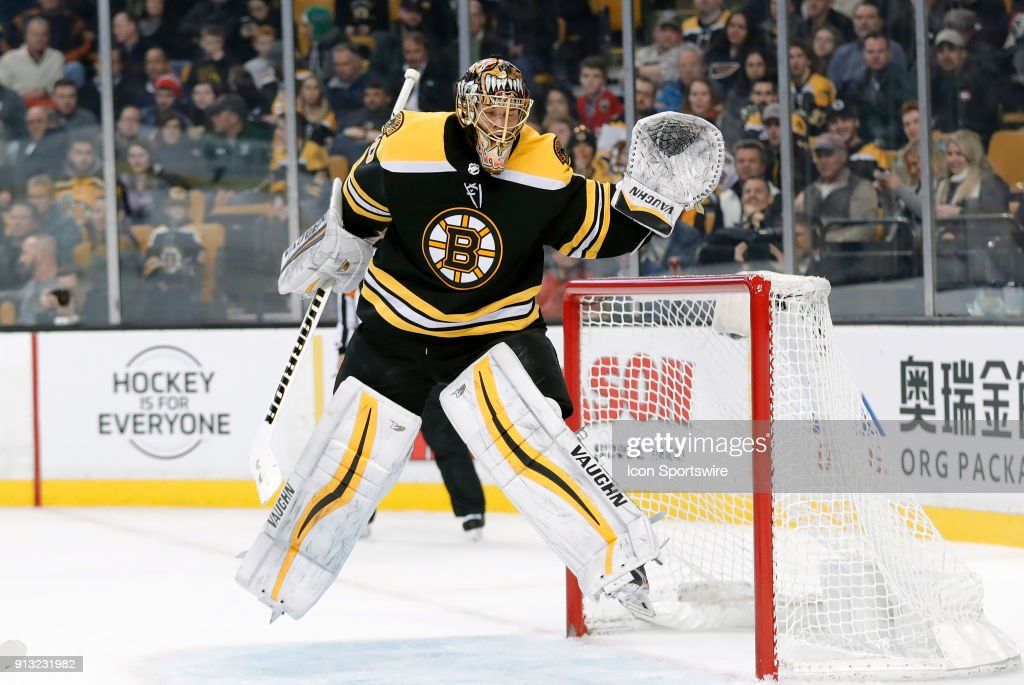 Boston Bruins goalie Tuukka Rask (40) gets airborne to keep a puck out of his net during a game between the Boston Bruins and the St. Louis Blues on February 1, 2018, at TD Garden in Boston, Massachusetts. The Bruins defeated the Blues 3-1.