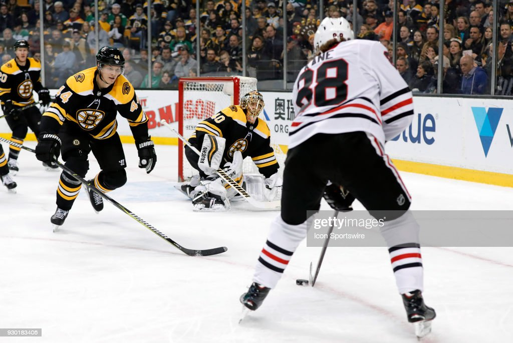 Boston Bruins goalie Tuukka Rask (40) keeps an eye on Chicago Blackhawks right wing Patrick Kane (88) as Boston Bruins left defenseman Nick Holden (44) moves in during a game between the Boston Bruins and the Chicago Blackhawks on March 10, 2018, at TD Garden in Boston, Massachusetts. The Bruins defeated the Blackhawks 7-4.