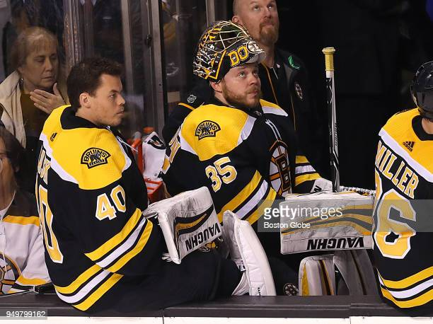 Boston Bruins goalie Tuukka Rask left and Anton Khudobin right sit on the bench late in the third period as Khudobin was pulled for a sixth player...