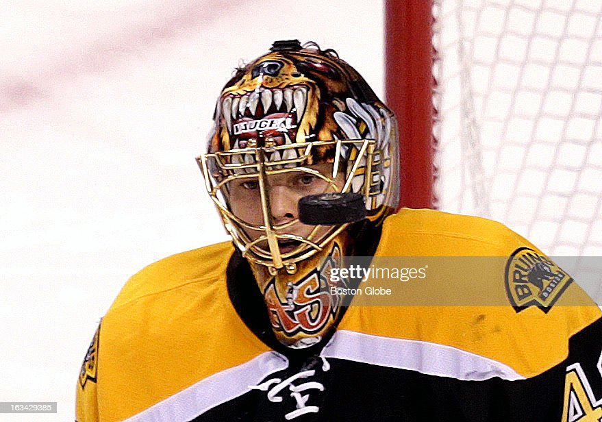 Boston Bruins goalie Tuukka Rask (#40) makes a face mask save during the second period as the Boston Bruins host the Philadelphia Flyers at TD Garden.