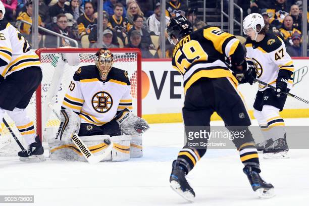 Boston Bruins Goalie Tuukka Rask makes a save on Pittsburgh Penguins Left Wing Jake Guentzel during the second period in the NHL game between the...