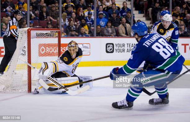 Boston Bruins Goalie Tuukka Rask makes a save on Vancouver Canucks Defenceman Nikita Tryamkin during a NHL hockey game on March 13 at Rogers Arena in...