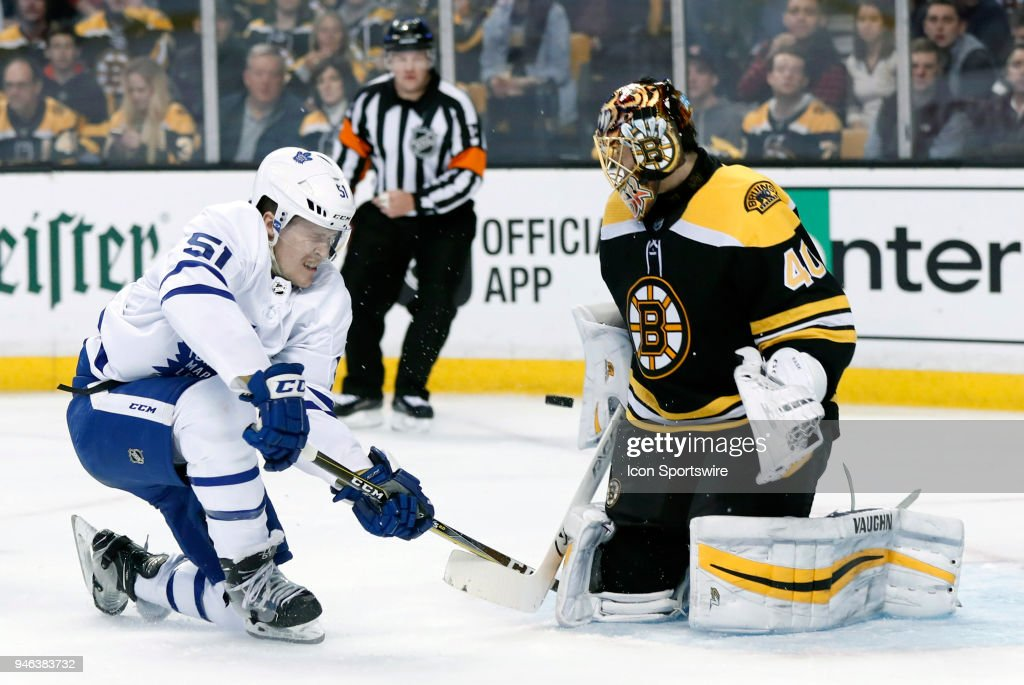 Boston Bruins goalie Tuukka Rask (40) makes the save on Toronto Maple Leafs defenseman Jake Gardiner (51) during Game 2 of the First Round for the 2018 Stanley Cup Playoffs between the Boston Bruins and the Toronto Maple Leafs on April 14, 2018, at TD Garden in Boston, Massachusetts. The Bruins defeated the Maple Leafs 7-3.