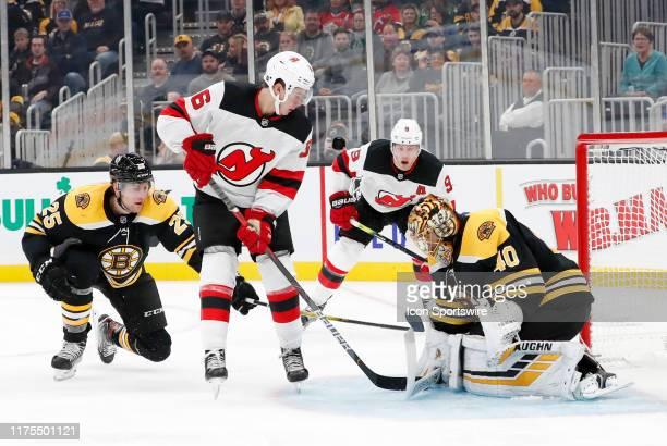 Boston Bruins goalie Tuukka Rask stops New Jersey Devils center Jack Hughes during a game between the Boston Bruins and the New Jersey Devils on...