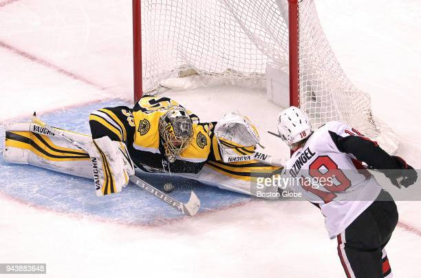 Boston Bruins goaltender Anton Khudobin makes a save on a point blank shot from Ottawa Senators left wing Ryan Dzingel during the second period The...