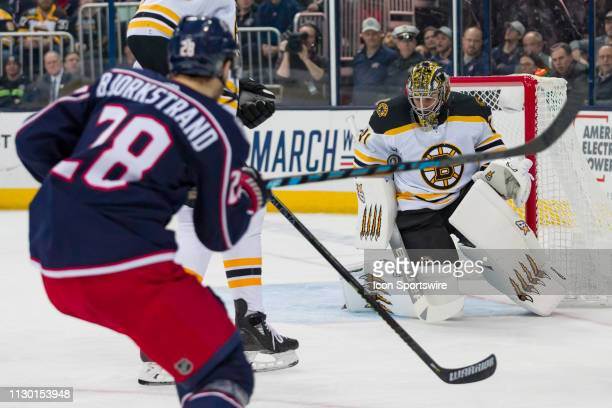 Boston Bruins goaltender Jaroslav Halak blocks a shot from Columbus Blue Jackets right wing Oliver Bjorkstrand in a game between the Columbus Blue...