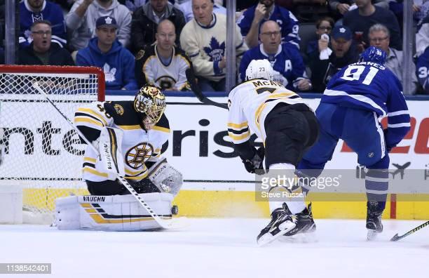 TORONTO ON APRIL 21 Boston Bruins goaltender Tuukka Rask stops Toronto Maple Leafs center John Tavares as the Toronto Maple Leafs play the Boston...