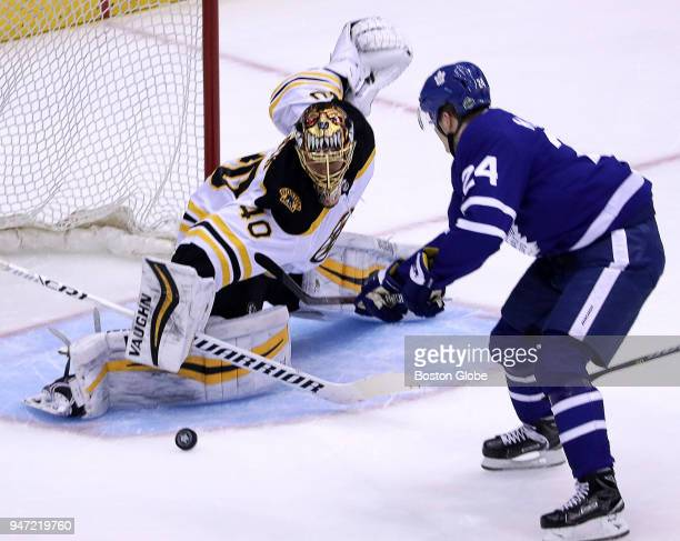 Boston Bruins goaltender Tuukka Rask turns away a shot by Toronto Maple Leafs right wing Kasperi Kapanen on a breakaway attempt in the first period...