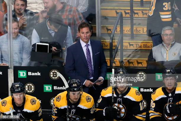 Boston Bruins head coach Bruce Cassidy during a game between the Boston Bruins and the Vancouver Canucks on October 19 at TD Garden in Boston...