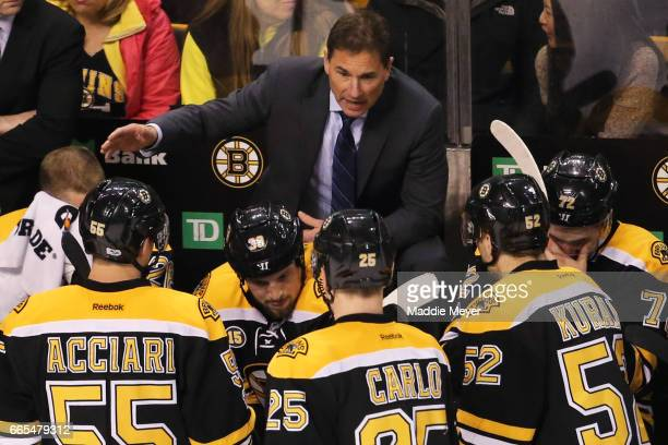 Boston Bruins head coach Bruce Cassidy speaks with his team during a timeout during the third period against the Ottawa Senators at TD Garden on...