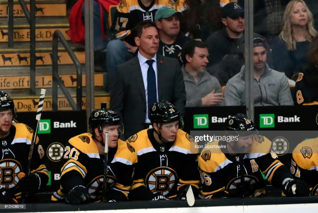 Boston Bruins head coach Bruce Cassidy watches play during a game between the Boston Bruins and the Anaheim Ducks on January 30, 2018, at TD Garden in Boston, Massachusetts. The Ducks defeated the Bruins 3-1.