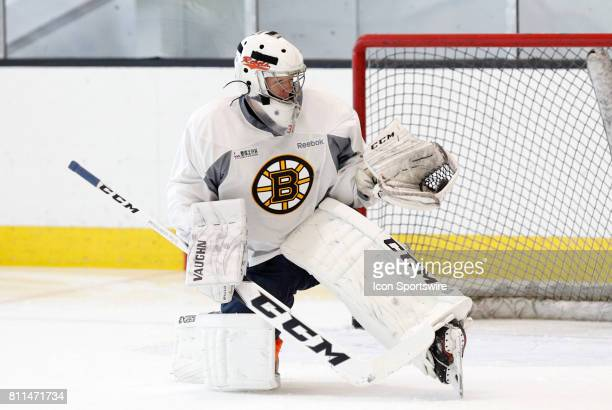 Boston Bruins invitee goalie James Corcoran makes a glove save during Bruins Development Camp on July 8 2017 at Warrior Ice Arena in Boston...