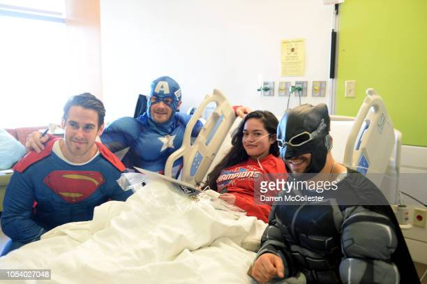 Boston Bruins John Moore Chris Wagner and Patrice Bergeron visit with Izzy at Boston Children's Hospital October 26 2018 in Boston Massachusetts