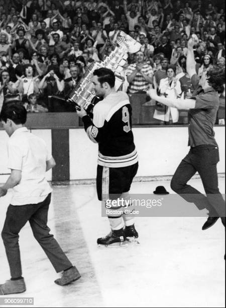 Boston Bruins Johnny Bucyk skates around the Boston Garden while holding the Stanley Cup May 10 1970