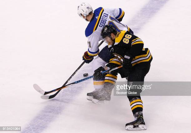 Boston Bruins' Kevan Miller right competes for the puck with St Louis Blues' Vladimir Sobotka during the second period The Boston Bruins host the St...