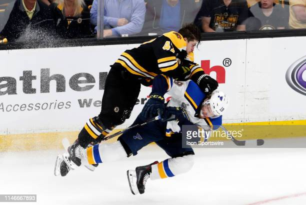 Boston Bruins left defenseman Torey Krug rocks St Louis Blues winger Robert Thomas during Game 1 of the 2019 Stanley Cup Finals between the Boston...