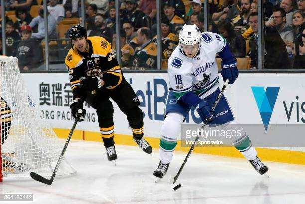 Boston Bruins left defenseman Zdeno Chara tries to cut off the centering pass from Vancouver Canucks right wing Jake Virtanen during a game between...