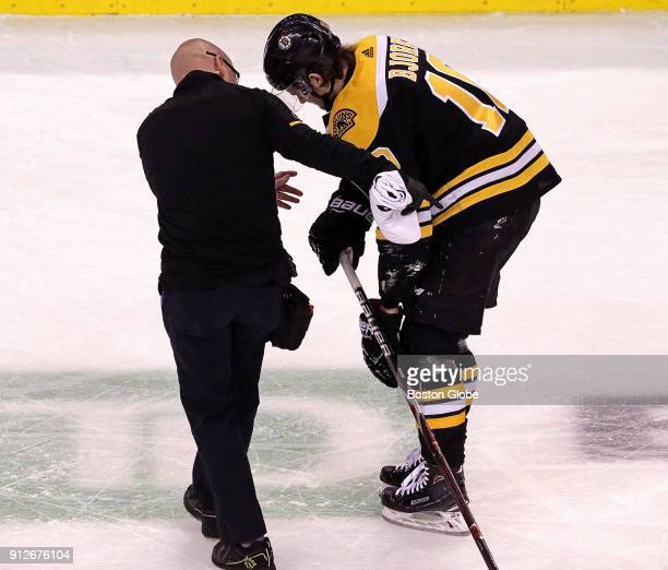 Boston Bruins left wing Anders Bjork is assisted off the ice after suffering an injury during the first period The Boston Bruins host the Anaheim...