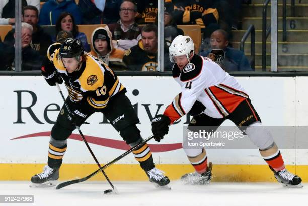 Boston Bruins left wing Anders Bjork takes the puck from Anaheim Ducks defenseman Cam Fowler during a game between the Boston Bruins and the Anaheim...