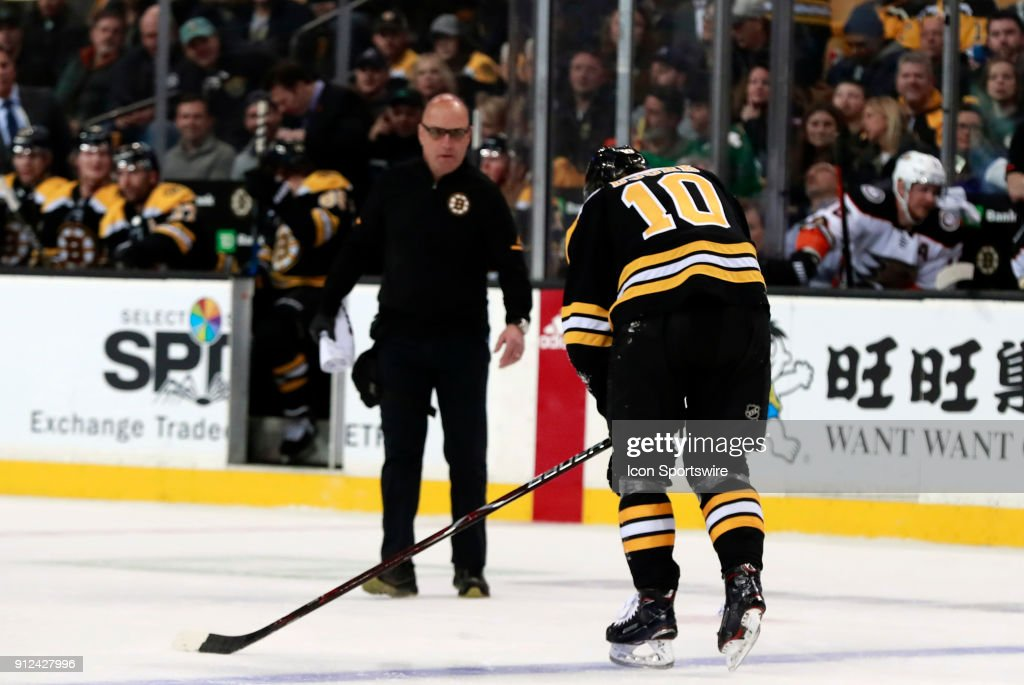 Boston Bruins left wing Anders Bjork (10) tries to get off the ice during a game between the Boston Bruins and the Anaheim Ducks on January 30, 2018, at TD Garden in Boston, Massachusetts. The Ducks defeated the Bruins 3-1.