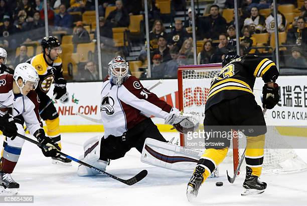 Boston Bruins left wing Brad Marchand can not finish his chance as Colorado Avalanche goalie Calvin Pickard tries to recover during a regular season...