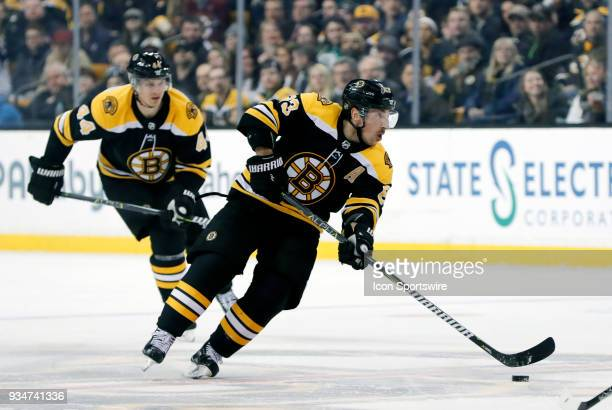 Boston Bruins left wing Brad Marchand carries the puck through the neutral zone during a game between the Boston Bruins and the Columbus Blue Jackets...