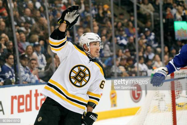 Boston Bruins Left Wing Brad Marchand celebrates his second goal in the first period during the regular season NHL game between the Boston Bruins and...