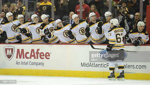 Boston Bruins left wing Brad Marchand celebrates with teammates after he scored on a penalty shot against the Washington Capitals in the first period...