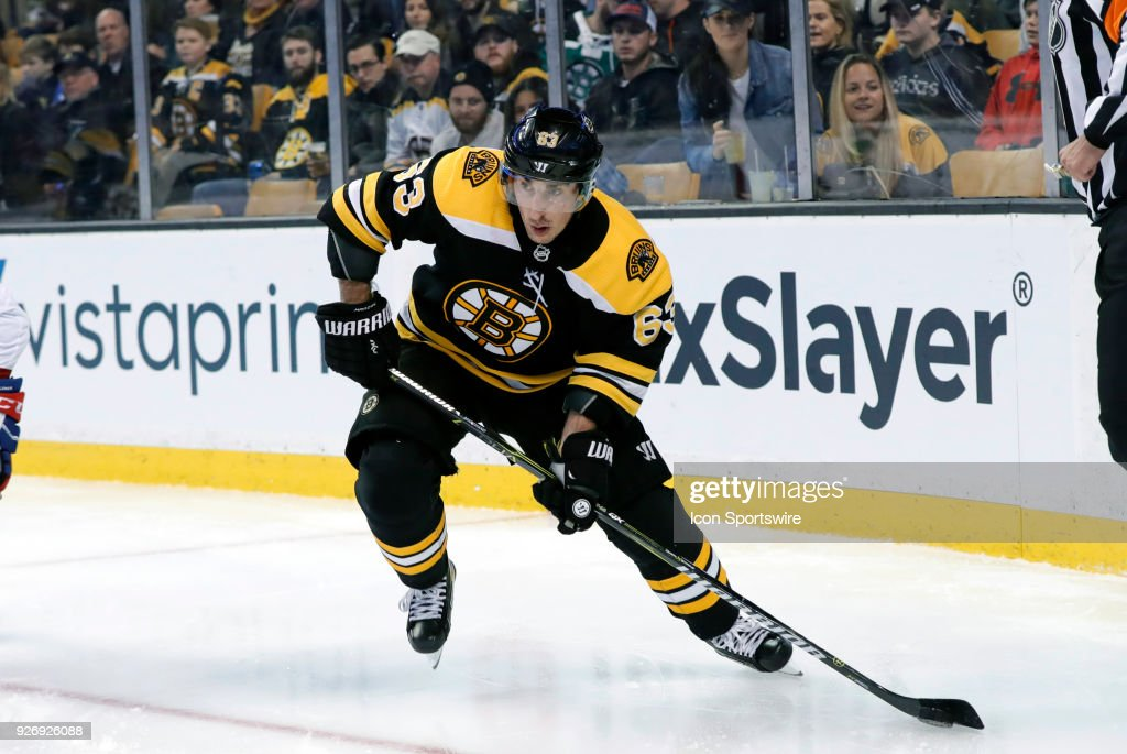 Boston Bruins left wing Brad Marchand (63) checks with the point during a game between the Boston Bruins and the Montreal Canadiens on March 3, 2018, at TD Garden in Boston, Massachusetts. The Bruins defeated the Canadiens 2-1 (OT).