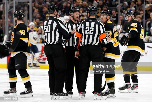 Boston Bruins left wing Brad Marchand questions a call from linesman Scott Cherrey and referee Ghislain Hebert during a game between the Boston...